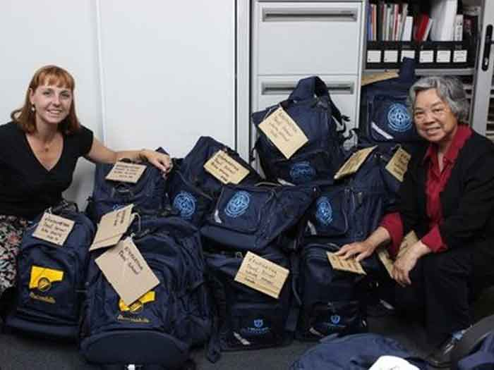 Jodie and Sarah packing bags of donations for Ephphatha School for the Deaf in the Democratic Republic of Congo